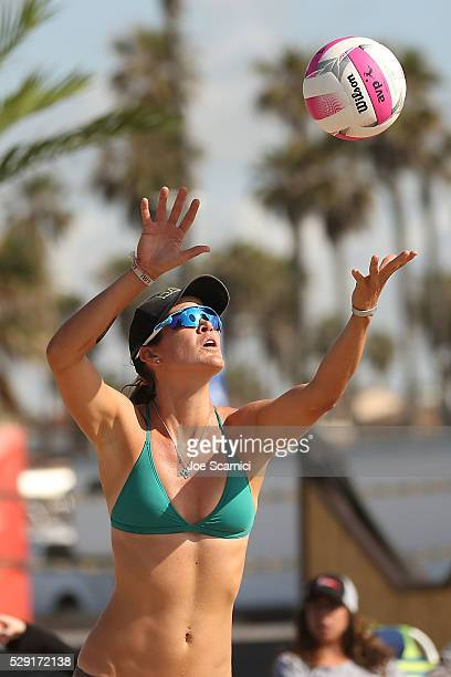 Angela Bensend serves the ball during the semi final match against Summer Ross and Lane Carico at the AVP Huntington Beach Open on May 08 2016 in...