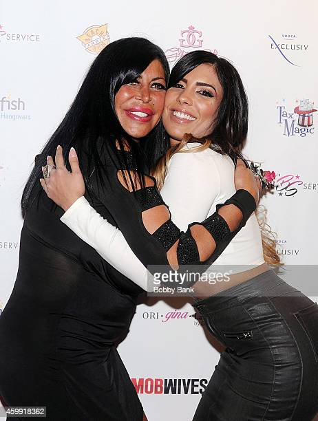 Angela Big Ang Raiola and Natalie Guercio of Mob Wives attends Mob Wives Season Five Viewing Party at Drunken Monkey on December 3 2014 in New York...