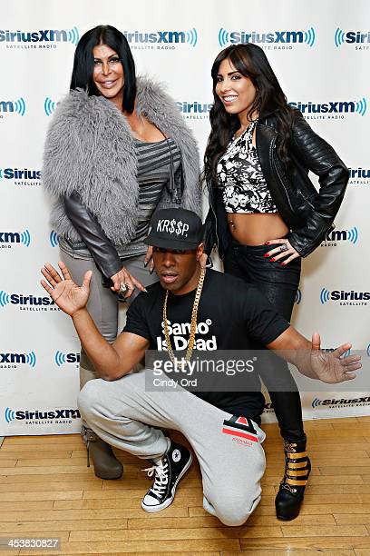 Angela 'Big Ang' Raiola and Natalie Guercio pose with SiriusXM host DJ Whoo Kid at the SiriusXM Studios on December 5, 2013 in New York City.