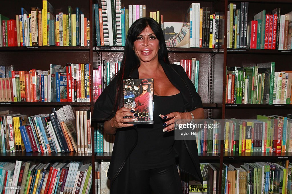 """Big Ang Signs Copies Of Her Book """"Bigger Is Better: Real Life Wisdom From the No-Drama Mama"""""""
