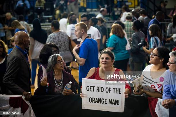 Angela Brown, a resident of Cuyahoga Falls, OH, holds a sign after former President Barack Obama spoke at a campaign rally for Ohio Gubernatorial...