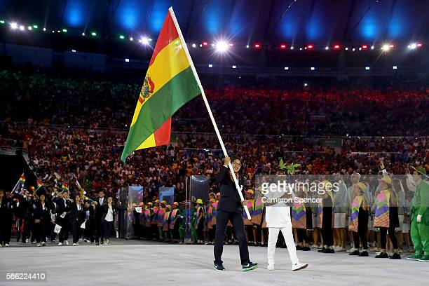 Angela Castro of Bolivia carries the flag during the Opening Ceremony of the Rio 2016 Olympic Games at Maracana Stadium on August 5 2016 in Rio de...