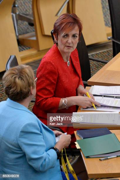 Angela Constance Cabinet Secretary for Communities and Annabelle Ewing Minister for Community Safety in the chamber of the Scottish Parliament before...