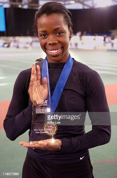 Angela Daigle poses witih VISA Championshiop Series trophy. Daigle won the women's 60 meters in 7.09 seconds in the USA Track & Field Indoor...