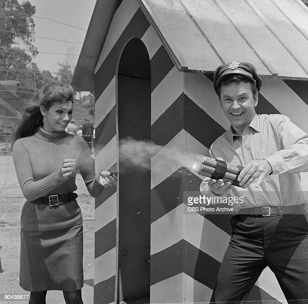 Angela Dorian as Carla and Bob Crane as Col Robert E Hogan in The Crittendon Plan an episode from the CBS comedy series 'Hogan's Heroes' June 21 1967