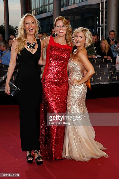 Angela Fingererben Miriam Lange and Jennifer Knaeble attend the Deutscher Fernsehpreis 2013 Red Carpet Arrivals at Coloneum on October 02 2013 in...