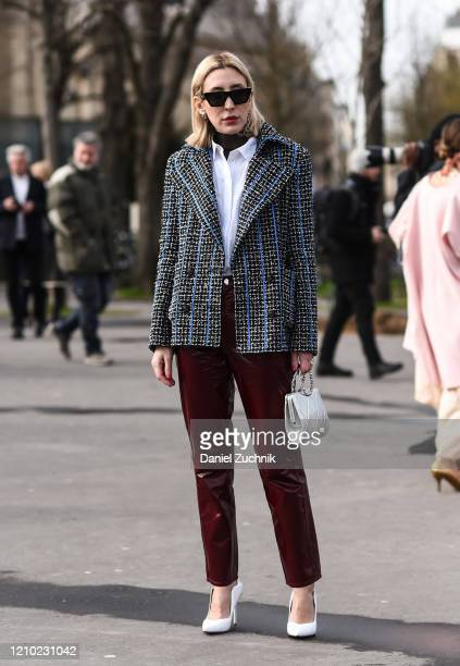 Angela Fink is seen wearing a checkered Chanel jacket outside the Chanel show during Paris Fashion Week AW20 on March 03 2020 in Paris France
