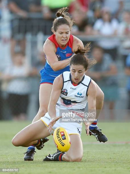 Angela Foley of the Crows is tackled by Emma Kearney of the Bulldogs during the 2017 AFLW Round 02 match between the Western Bulldogs and the...