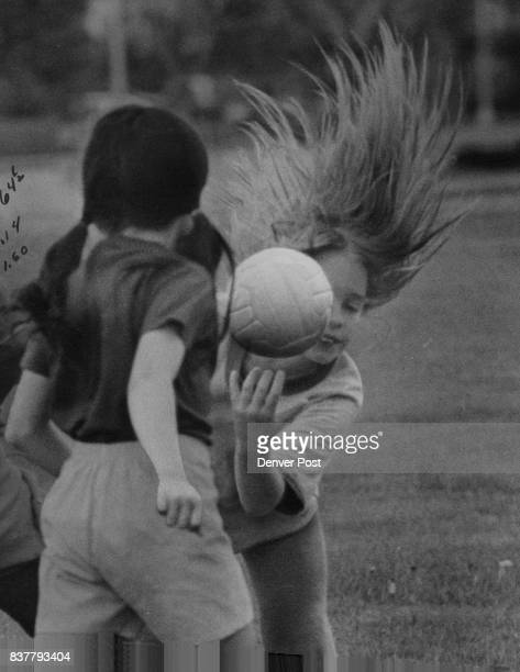 Angela Foucher demonstrates hairraising action of new field handball game played at Montbello soccer picnic by members of Golden Lassies and Snappy...