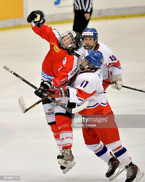 Angela Frautschi of Switzerland and Simona Studentova of Czech Republic tries to reach for the pack during the match between Czech Republic and...