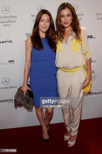Angela Gessmann and Jana Ina Zarella attend the Laurel Show during the MercedesBenz Fashion Week Spring/Summer 2014 at Brandenburg Gate on July 4...