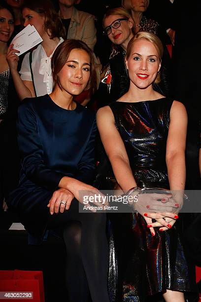 Angela Gessmann and Judith Rakers arrive for the Guido Maria Kretschmer Show during MercedesBenz Fashion Week Autumn/Winter 2014/15 at Brandenburg...