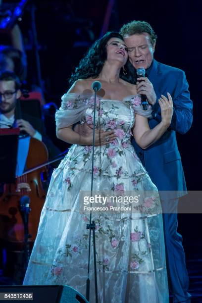 Angela Gheorghiu and Massimo Ranieri perform at Luciano Pavarotti 10th Anniversary Concert in Arena di Verona on September 6 2017 in Verona Italy