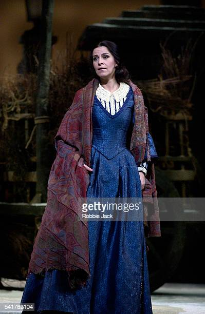 Angela Gheorghiu in the Royal Opera's production of La Boheme at the Royal Opera House Covent Garden London Composer Giacomo Puccini