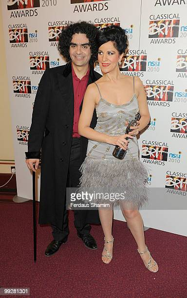 Angela Gheorghiu poses with The Female Artist of the Year Award with Rolando Villazon in the Winners room at the Classical BRIT Awards at Royal...