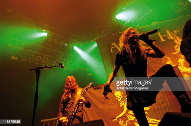 Angela Gossow and Michael Amott of Swedish death metal group Arch Enemy performing live on stage at the Motorpoint Arena in Cardiff during the Black...
