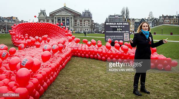 Angela Groothuizen Dutch ambassador for Stop AIDS Now prepares to release red balloons representing women who have died of the disease on World AIDS...