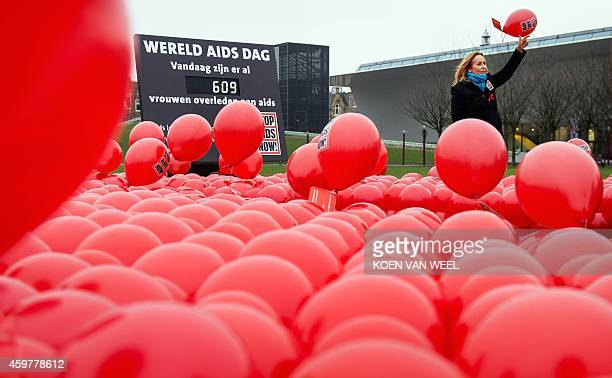 Angela Groothuizen Dutch ambassador for Stop AIDS Now releases red balloons representing women who have died of the disease on World AIDS Day at the...