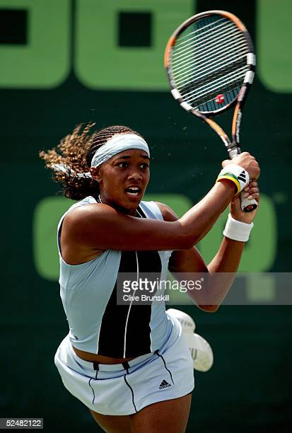 Angela Haynes of the USA returns a shot to Tatiana Golovin of France during the NASDAQ-100 Open at the Crandon Park Tennis Center on March 26, 2005...