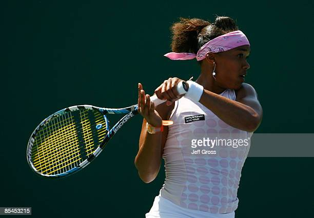 Angela Haynes returns a forehand to Flavia Pennetta during the BNP Paribas Open at the Indian Wells Tennis Garden on March 16, 2009 in Indian Wells,...
