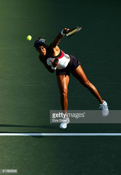 Angela Haynes serves to Francesca Schiavone of Italy during the US Open September 3, 2004 at the USTA National Tennis Center in Flushing Meadows...