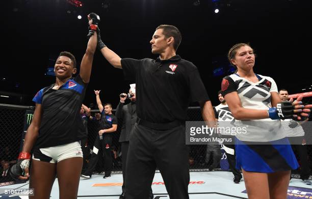 Angela Hill celebrates after her unanimousdecision victory over Ashley Yoder in their women's strawweight bout during The Ultimate Fighter Finale at...