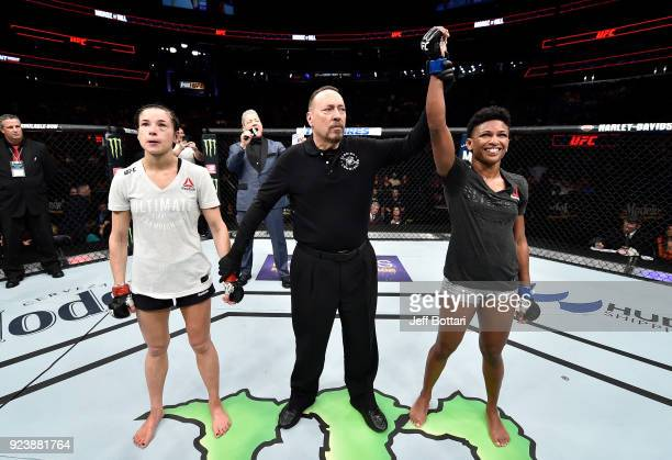 Angela Hill celebrates after her unanimousdecision victory over Maryna Moroz of Ukraine in their women's strawweight bout during the UFC Fight Night...