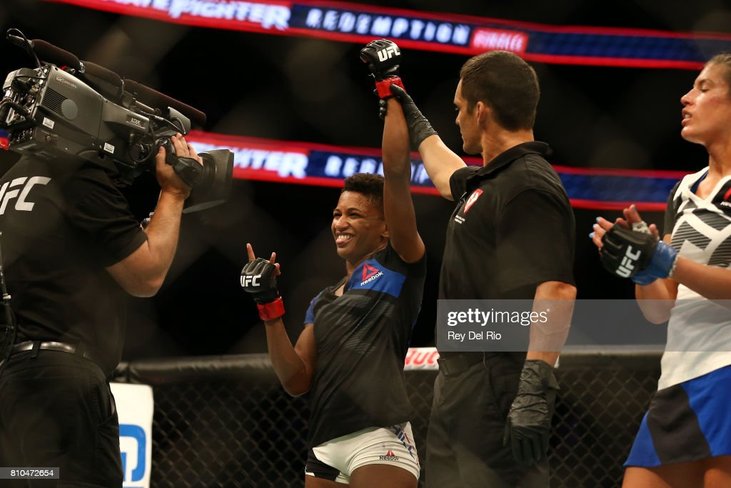 Angela Hill celebrates after her victory over Asley Yoder during The Ultimate Fighter Finale event inside the T-Mobile Arena on July 7, 2017 in Las Vegas, Nevada.