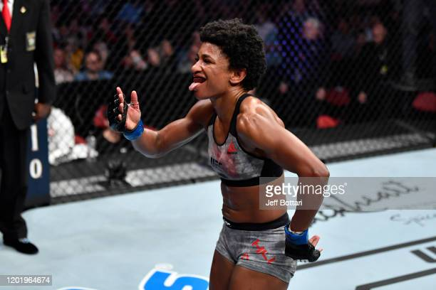 Angela Hill celebrates her TKO victory over Hannah Cifers in their women's strawweight bout during the UFC Fight Night event at PNC Arena on January...