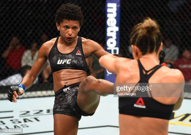 Angela Hill kicks Cortney Casey in their womens strawweight fight during the UFC Fight Night event at Pinnacle Bank Arena on August 25 2018 in...