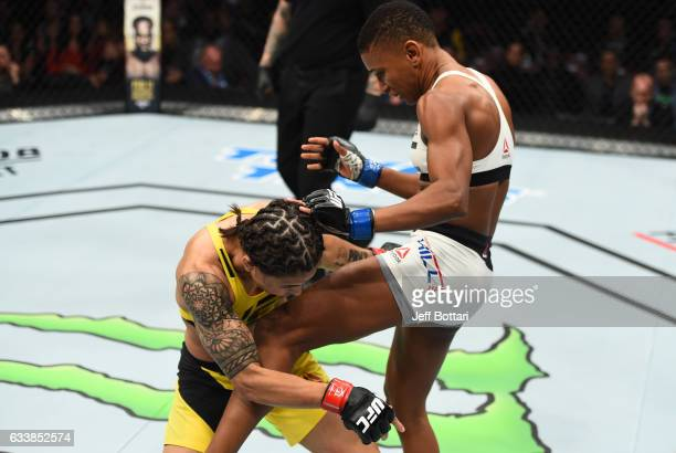 Angela Hill knees Jessica Andrade of Brazil in their women's strawweight bout during the UFC Fight Night event at the Toyota Center on February 4...
