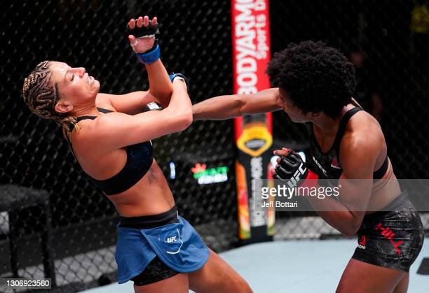 Angela Hill punches Ashley Yoder in a strawweight fight during the UFC Fight Night event at UFC APEX on March 13, 2021 in Las Vegas, Nevada.