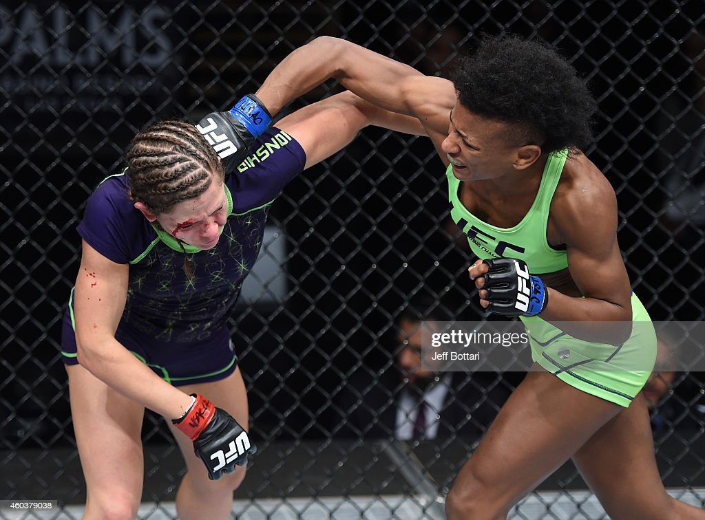 Angela Hill punches Emily Kagan in their strawweight fight during The Ultimate Fighter Finale event inside the Pearl concert theater at the Palms Casino Resort on December 12, 2014 in Las Vegas, Nevada.