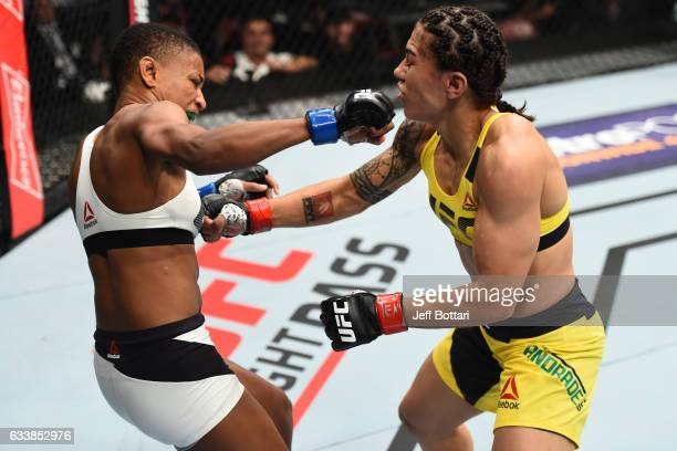 Angela Hill punches Jessica Andrade of Brazil in their women's strawweight bout during the UFC Fight Night event at the Toyota Center on February 4...
