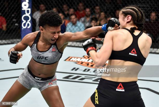 Angela Hill punches Maryna Moroz of Ukraine in their women's strawweight bout during the UFC Fight Night event at Amway Center on February 24 2018 in...