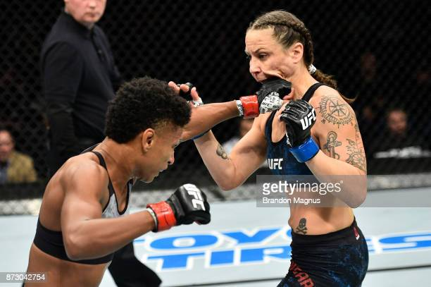 Angela Hill punches Nina Ansaroff in their women's strawweight bout during the UFC Fight Night event inside the Ted Constant Convention Center on...