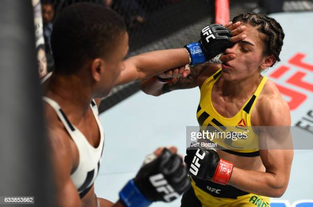 Angela Hill pushes Jessica Andrade of Brazil in their women's strawweight bout during the UFC Fight Night event at the Toyota Center on February 4...