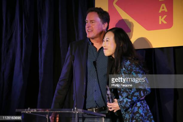 Angela Kang accepts the TV Series of the Year Showrunner Award from Steve Bellamy Kodak President of Motion Picture and Entertainment onstage during...