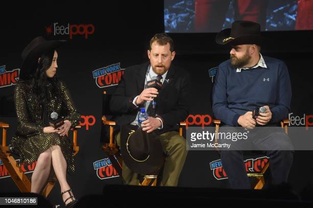 Angela Kang Scott M Gimple and Robert Kirkman speak onstage during the NYCC panel and fan screening of 'The Walking Dead' episode 901 at The Theater...
