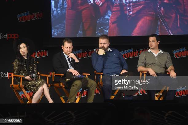 Angela Kang Scott M Gimple Robert Kirkman and David Alpert speak onstage during the NYCC panel and fan screening of 'The Walking Dead' episode 901 at...