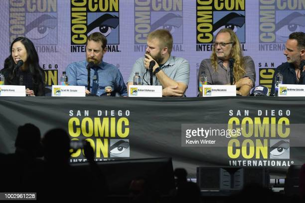 Angela Kang Scott M Gimple Robert Kirkman Greg Nicotero and Andrew Lincoln speak onstage at AMC's 'The Walking Dead' panel during ComicCon...