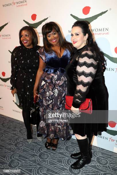 Angela Kissane poses with guests at the Women For Women International Gala at The Ziegfeld Ballroom on November 29 2018 in New York City