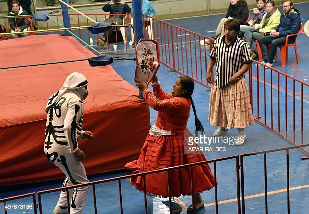 """""""Angela la Folclorica"""" fights outside the ring with """"Carla Greta"""" during a """"cholitas"""" all-in wrestling fight in El Alto, 12 Kms from la Paz on..."""