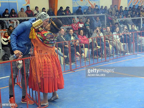 Angela la Folclorica kisses a tourist at the end of a cholitas allin wrestling fight in El Alto 12 Kms from la Paz on November 15 20152015 The...