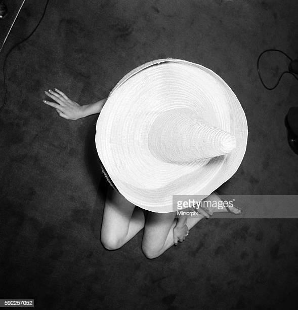 Angela Lane wearing madetomeasure swimsuits and fancy straw beach hats June 1960 M4240002