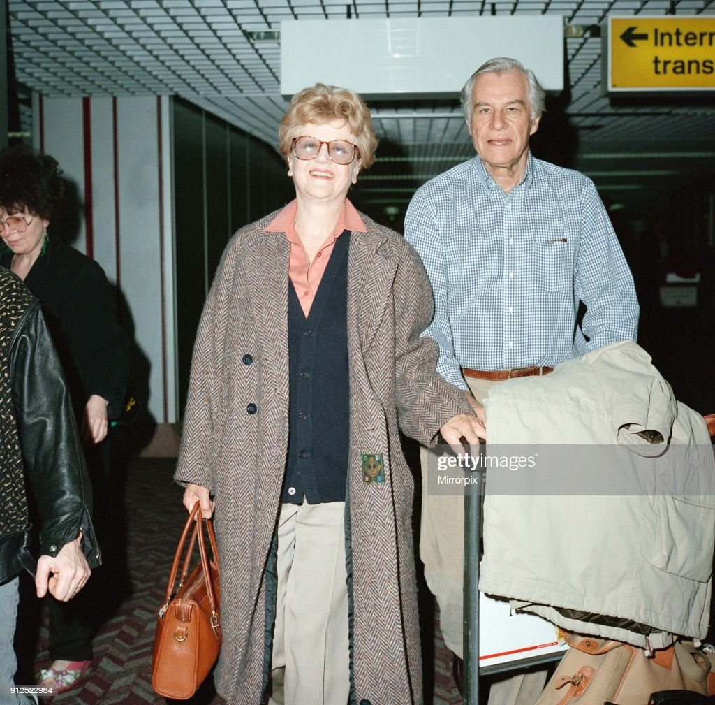 Angela Lansbury and husband Peter Shaw at London Airport, 13th March 1990.