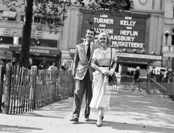 Angela Lansbury and Peter Shaw pictured walking in Leicester Square London 26th July 1949