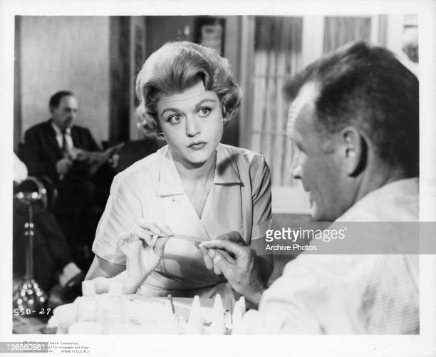 Angela Lansbury holding a small wooden stick in a scene from the film 'Season Of Passion' 1960