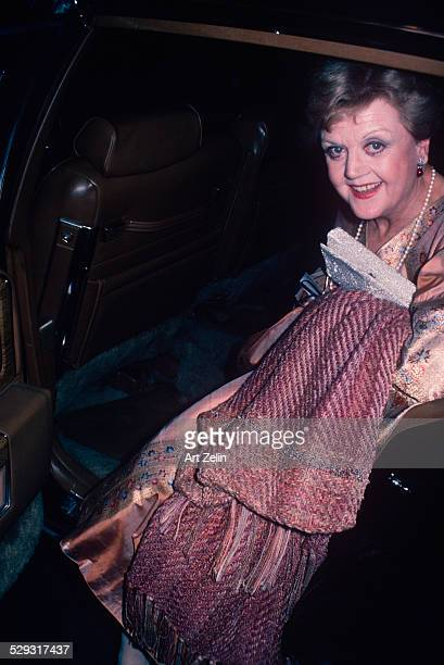 Angela Lansbury wearing a formal dress getting out of a limousine circa 1970 New York