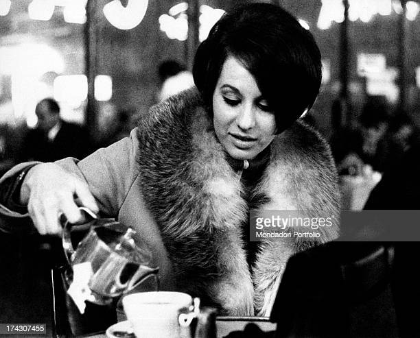 Angela Lippi the fiancèe of Pippo Baudo drinking a cup of tea Milan 1967